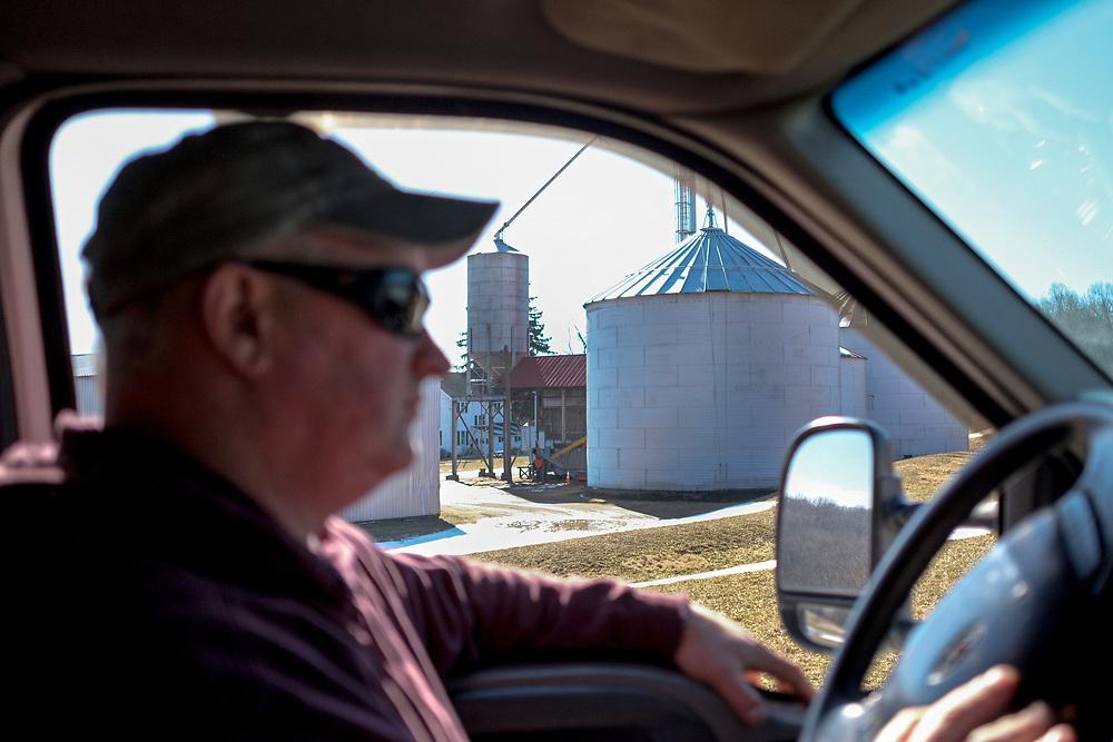 Grain farmer Scott Clucas drives on his farm on Feb. 4, 2019, in Port Clinton, New Jersey.