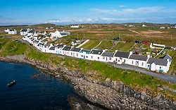 Aerial view of whitewashed houses in village of Portnahaven on Rhinns of Islay on Islay , Inner Hebrides, Scotland UK