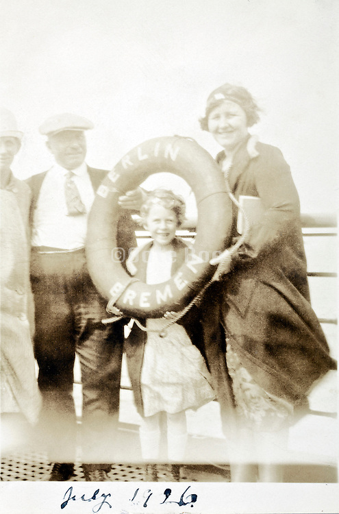 fading family snap from 1926 on ship with life preserver