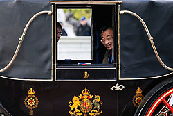 © Licensed to London News Pictures. 05/11/2013. London, United Kingdom.  A member of the Korean delegation peers out of a carriage during a  State Visit to the UK by President of the Republic of Korea, Park Geun-hye. Photo credit : Andrea Baldo/LNP