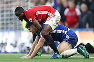 Eric Bailly of Manchester United grabs Gary Cahill of Chelsea. Premier league match, Chelsea v Manchester Utd at Stamford Bridge in London on Sunday 23rd October 2016.<br /> pic by John Patrick Fletcher, Andrew Orchard sports photography.