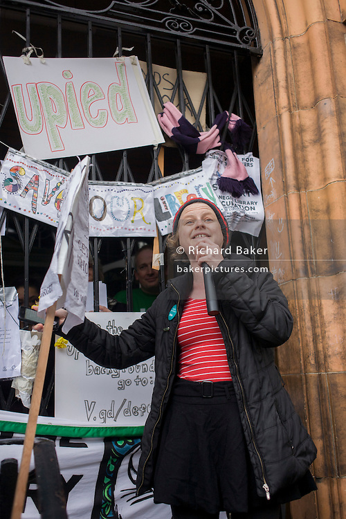 Jemima Foxtrot a singer and performance poet recites outside Carnegie Library in Herne Hill, south London while occupiers remain inside the premises on day 8 of its occupation, 7th April 2016. The angry local community in the south London borough have occupied their important resource for learning and social hub for the weekend. After a long campaign by locals, Lambeth have gone ahead and closed the library's doors for the last time because they say, cuts to their budget mean millions must be saved.