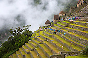 Terracing at the Ancient site of Machu Pichu in the Cusco region of Pery. The Incans were known for their use of agricultural terracing and Machu Pichu's extensive stone terraces are a prime example of this practice. Terraces created larger areas for growing crops and allowed use of the more intense and longer sunlight exposure on the mountain sides during the day. Terracing also prevented soil erosion, mudslides and flooding and allowed farmers to better control the amount of water that fed the crops.
