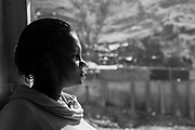 Eline, looking out from the windowless hut that she hopes to live in. Little Haiti is born.