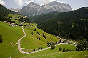 Winding rural road and traffic in Dolomites near La Val in Alta Badia, south Tyrol, Italy.