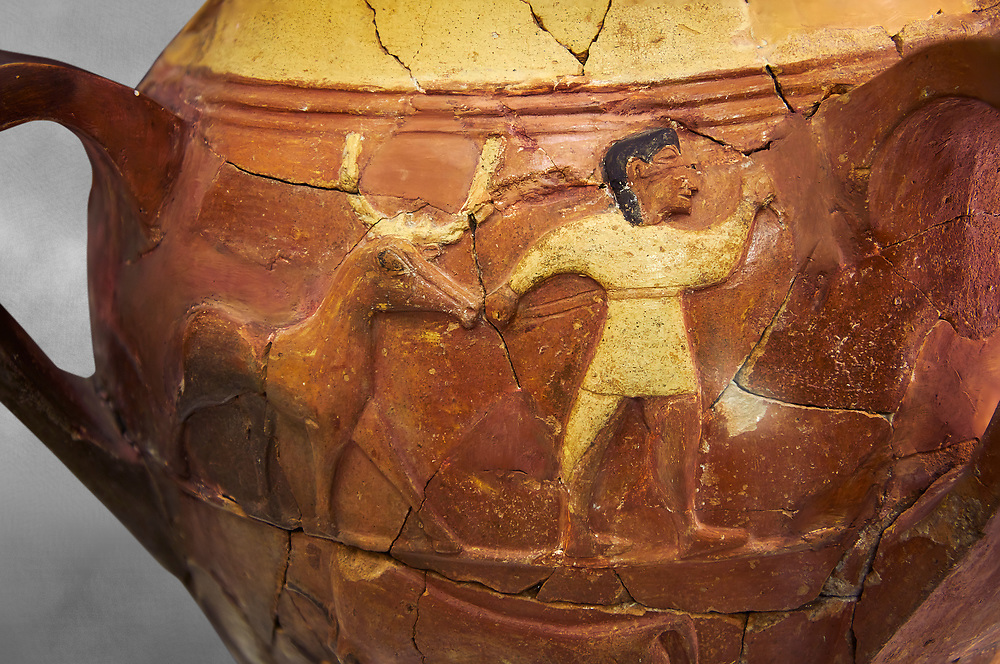 Hüseyindede vases, Old Hittite Polychrome Relief vessel, third freeze down depicting a man leading a bull, 16th century BC. Huseyindede . Çorum Archaeological Museum, Corum, Turkey. Against a grey bacground. .<br /> <br /> If you prefer to buy from our ALAMY STOCK LIBRARY page at https://www.alamy.com/portfolio/paul-williams-funkystock/hittite-art-antiquities.html  - Huseyindede into the LOWER SEARCH WITHIN GALLERY box. Refine search by adding background colour, place, museum etc<br /> <br /> Visit our HITTITE PHOTO COLLECTIONS for more photos to download or buy as wall art prints https://funkystock.photoshelter.com/gallery-collection/The-Hittites-Art-Artefacts-Antiquities-Historic-Sites-Pictures-Images-of/C0000NUBSMhSc3Oo
