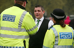 Hyde Park, London, 20/04/2014<br /> Stuart Harper, a political lobbist for NORML UK, a pro-cannabis group that campaigns for reforms to cannabis laws, talks to police as tensions flare between police and people attending a pro-cannabis rally in Hyde Park, central London. <br /> Photo: Anna Branthwaite/LNP