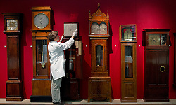 © Licensed to London News Pictures. 26/10/2012. London, UK. Richard Horton, a Science Museum Conservator, poses with a Regulator Clock by Cope and Molyneux (circa 1822) as the museum prepares to put its clocks back by an hour with the rest of the Britain this Sunday (28/10/12). Photo credit: Matt Cetti-Roberts/LNP
