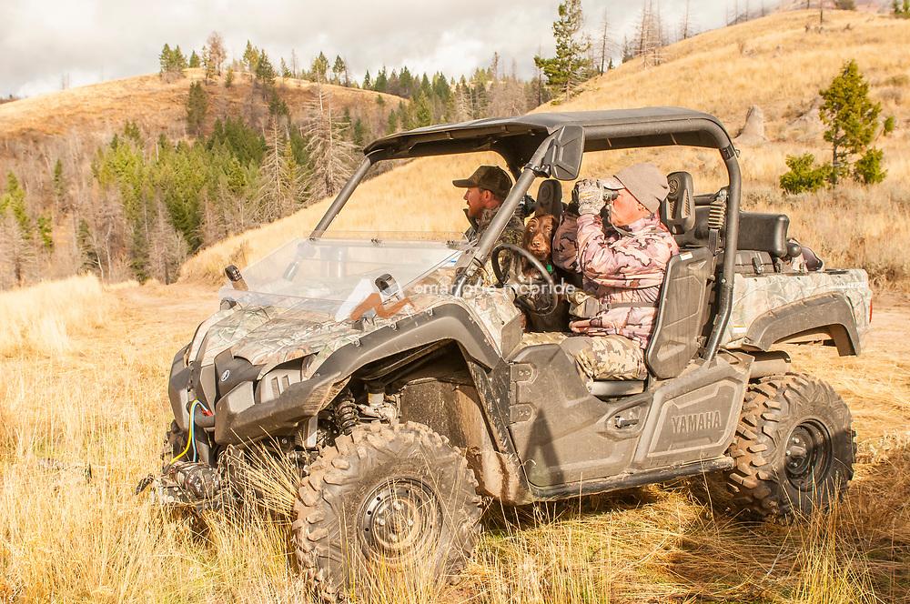 Hunters and dog in mountains on UTV. Fairfield, Idaho