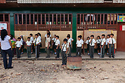 Students in the courtyard of a school in Boca Colorado, a town formed entirely by mining activity in the Peruvian Amazon.