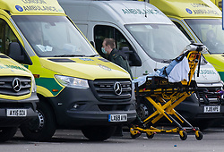 © Licensed to London News Pictures. 30/12/2020. London, UK. A patient is wheeled from an ambulance at The Queen's Hospital in Romford east London. The Medicines and Healthcare products Regulatory Agency (MHRA) has authorised the Oxford University Astra Zeneca coronavirus vaccine for use in the UK. Photo credit: Peter Macdiarmid/LNP