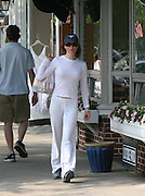 **EXCLUSIVE**.Renee Zellweger sporting new red hair, trying to look incognito with a hat and sunglasses, goes on a shopping spree stopping first at a health food Store Second Nature, buys plenty of teas and vitamins, then makes a quick stop at Intermix and Saks Fifth Avenue Stores..Southampton, NY, United States .Sunday, July 02, 2006.Photo By Celebrityvibe.com.To license this image please call (212) 410 5354; or.Email: sales@celebrityvibe.com ;.Website: www.celebrityvibe.com ...