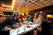 November 18, 2016_San Diego, California_USA_  At Kindred on 30th. Street in the Southpark neighorhood bartender Jason Stanley speaks with customers Madeleine Dodge, left, and Tessa Carpenter, at right.  _Mandatory Photo Credit: Photo by Charlie Neuman/San Diego Union-Tribune/Copyright 2016 San Diego Union-Tribune, LLC