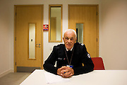 An anonymous Immigration Officer (IMO) with the UK Border Agency sits in a detention interview room Heathrow Airport's T5