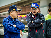09 OCTOBER 2018 - SEOUL, SOUTH KOREA: Buyers chat during an auction in the Noryangjin Fish Market. The buyer on the left is signalling a bid with his hand. The auctions start about 01.00 AM and last until 05.00 AM. Noryangjin Fish Market is the largest fish market in Seoul and has been in operation since 1927. It opened in the current location in 1971 and was renovated in 2015. The market serves both retail and wholesale customers and has become a tourist attraction in recent years.           PHOTO BY JACK KURTZ