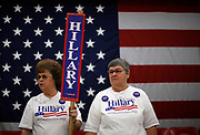 Deb Kenel (L) and her sister Sandy Gathers, supporters of U.S. Democratic presidential candidate U.S. Senator Hillary Clinton (D-NY), attend a campaign stop at Fort Madison High School in Fort Madison, Iowa December 31, 2007. REUTERS/Jim Young