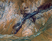 The oldest material on Earth which has yet been dated by man is a zircon mineral of 4.4 billion years old from a sedimentary gneiss in the Jack Hills of the Narre Gneiss Terrane of Australia. October 12, 2004. Satellite image.