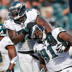 Philadelphia Eagles defensive end Fletcher Cox #91 celebrates with Philadelphia Eagles defensive end Vinny Curry #75 after Cox scored a touchdown off of a fumble recovery during the NFL Game between The Jacksonville Jaguars and the Philadelphia Eagles at Lincoln Financial Field in Philadelphia on Sunday September 7th 2014. The Eagles won 34-17. (Brian Garfinkel/Philadelphia Eagles)