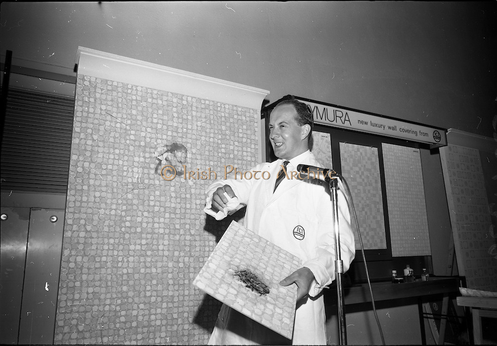 """23/06/1965<br /> 06/23/1965<br /> 23 June 1965<br /> I.C.I. (Imperial Chemical Industries) """"Vymura""""  luxury wall covering (wallpaper?) demonstration at the Intercontinental Hotel, Dublin. They threw eggs at the speaker but Mr. Alistair Fulton, (Technical Representative of the Paints Division, I.C.I.) welcomed the chance to show how even eggs could be washed off the new Vymura wall covering."""