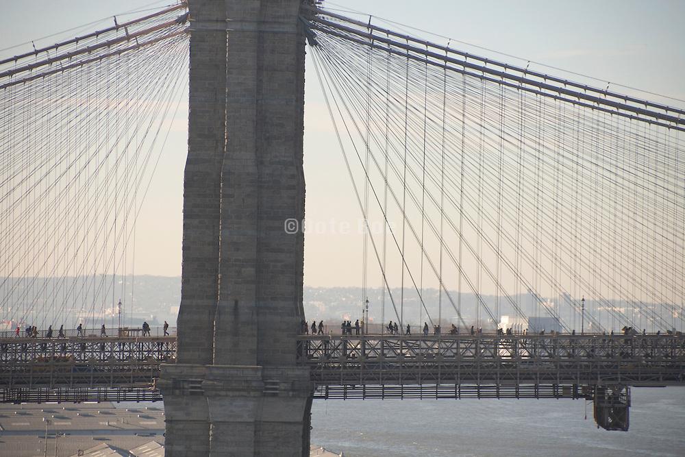 people walking towards work during subway strike New York City December 2005 crossing the Brooklyn Bridge