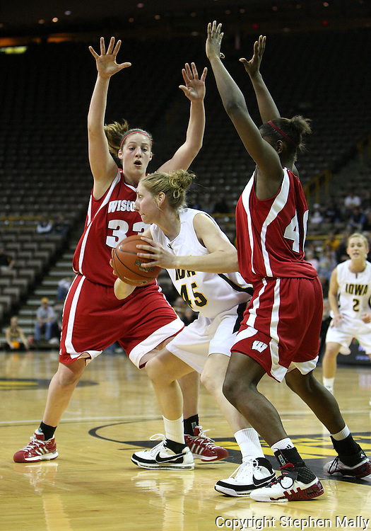 19 February 2009: Iowa forward/center JoAnn Hamlin (45) tries to pass the ball around Wisconsin forward Lin Zastrow (33) and Wisconsin forward Anya Covington (40) during the first half of an NCAA women's college basketball game Thursday, February 19, 2009, at Carver-Hawkeye Arena in Iowa City, Iowa. Iowa defeated Wisconsin 72-65.