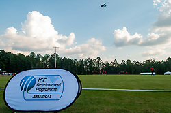 September 22, 2018 - Morrisville, North Carolina, US - Sept. 22, 2018 - Morrisville N.C., USA - An airliner makes a final approach to Raleigh-Durham International Airport over the cricket pitch during the ICC World T20 America's ''A'' Qualifier cricket match between USA and Canada. Both teams played to a 140/8 tie with Canada winning the Super Over for the overall win. In addition to USA and Canada, the ICC World T20 America's ''A'' Qualifier also features Belize and Panama in the six-day tournament that ends Sept. 26. (Credit Image: © Timothy L. Hale/ZUMA Wire)
