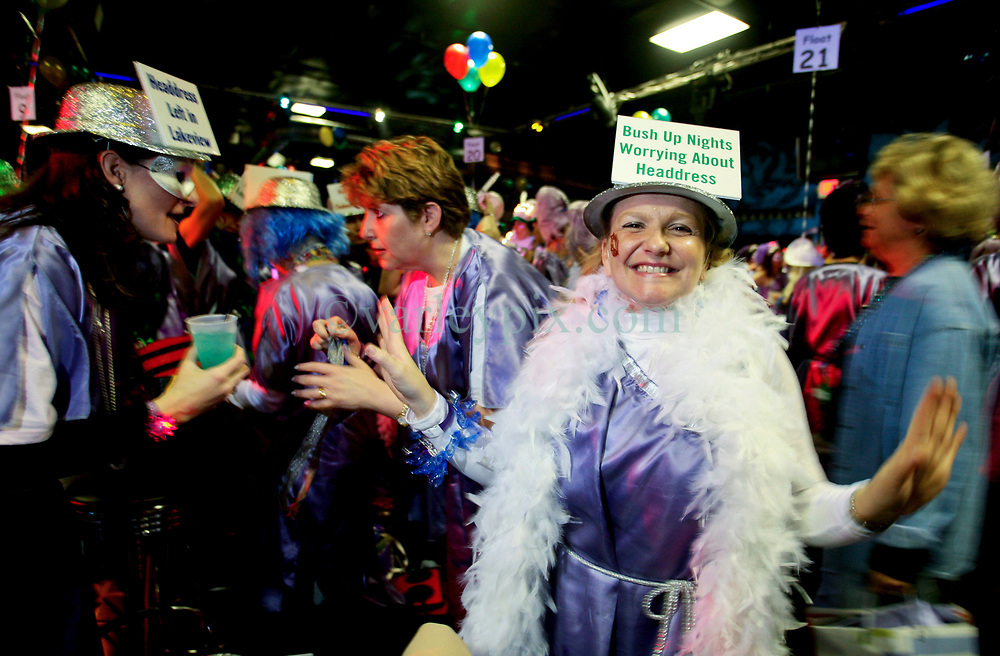 23 Feb 2006. New Orleans, Louisiana. The Krewe of Muses pre float boarding party at The Venue club. Muses is the only all women's Krewe to parade in New Orleans and is known for its satire, famous shoe throws and is generally considered one of the most popular parades of the Mardi Gras.<br /> Photo © Charlie Varley/varleypix.com