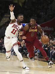 October 24, 2017 - Cleveland, OH, USA - The Cleveland Cavaliers' Dwayne Wade drives against the Chicago Bulls' David Nwaba (11) during the first quarter on Tuesday, Oct. 24, 2017, at Quicken Loans Arena in Cleveland. (Credit Image: © Phil Masturzo/TNS via ZUMA Wire)