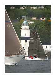 Yachting- The first days racing  of the Bell Lawrie Scottish series 2003 at Gourock.  The wet start looks set to last for the overnight race to Tarbert...The bow of Desperado closes in on Dave Ovington in his Mumm 30  'Ovington Boats' at Cloch Lighthouse..Class One...Pics Marc Turner / PFM