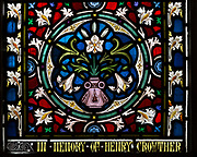 Detail of ornamental stained glass window with lily flowers and floral decoration, All Saints church, Stanton St Bernard, Wiltshire by Lavers and Barraud 1867