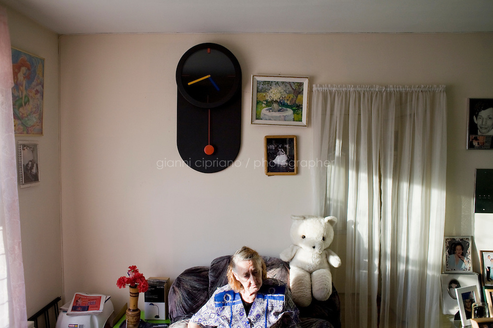"""27 October, 2008. New York. Faina El'man Ryzhikova, 82, a Jewish holocaust survivor and guerilla fighter, is here in her apartment in Bensonhurst, Brooklyn, NY. After asking for help, the Edith and Carl Marks Jewish Community House of Bensonhurst assisted her by tapping The New York Times Needieset funds for utility expenses of $50/month for 6 months, the first grant starting on October 3, 2008.<br /> <br /> Faina Ryzhikova was born in 1926 in Radoshkovichi, a little village 22 miles northwest from Minsk, Belarus. Back in 1939, this territory belonged to Poland. When the Germans occupied Radoshkovichi, in 1941, they created a ghetto, where Faina and her family lived and worked. In order to escape a planned pogrom by the Germans in 1942, Faina escaped into the forest where she later met the partisans of the brigade """"Narodnie Mstiteli"""" (Avengers of the people), which she joined.<br /> <br /> Faina's mother and sisters were killed while trying to escape. Her father survived and joined aina in 1943. Of the 2000 people that lived in the Radoshkovichi ghetto, only 18 survived. She married Vladimir Ryzhikov in 1954 and raised two sons. Faina's husband passed away in 1991, before the family came to the United States.<br /> <br /> <br /> ©2008 Gianni Cipriano for The New York Times<br /> cell. +1 646 465 2168 (USA)<br /> cell. +1 328 567 7923 (Italy)<br /> gianni@giannicipriano.com<br /> www.giannicipriano.com"""