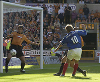 Copyright Sportsbeat Images. 01494 783165<br />Picture: Henry Browne<br />Date: 30/08/2003<br />Woverhampton Wanderers v Portsmouth FA Barclaycard Premiership<br />Paul Butler of Wolves clears Teddy Sheringham's shot off the line