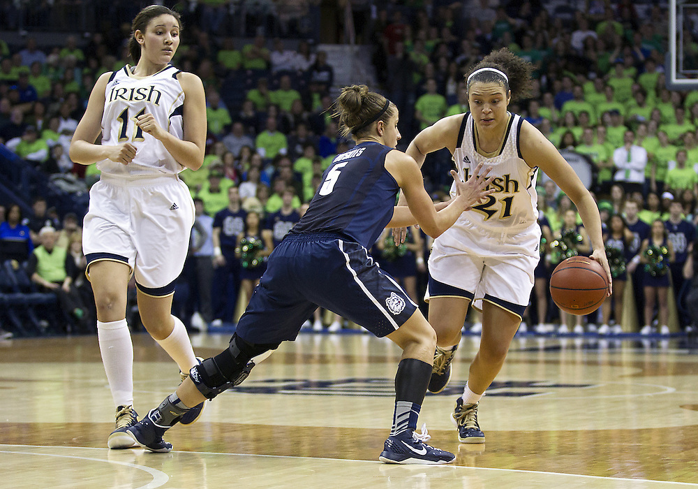 March 04, 2013:  Notre Dame guard Kayla McBride (21) dribbles the ball as Connecticut guard Caroline Doty (5) defends during NCAA Basketball game action between the Notre Dame Fighting Irish and the Connecticut Huskies at Purcell Pavilion at the Joyce Center in South Bend, Indiana.  Notre Dame defeated Connecticut 96-87 in triple overtime.