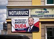 Plakat wyborczy Andrzeja Dudy i reklama notariusza