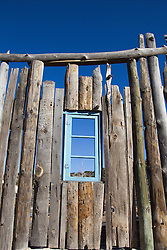 window-in-a-wooden-fence-found-in-New-Mexico