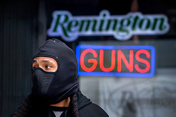 March 17, 2020, Burbank, California, USA: Rapper RON DEUCE, of North Hollywood, waits for a second day to purchase ammunition and a second gun at Gun World in Burbank on Tuesday as US sales of guns and ammunition soar amid the coronavirus outbreak. The store had a line down the block. (Credit Image: © Sarah Reingewirtz/Orange County Register via ZUMA Wire)