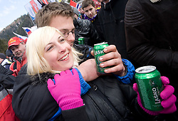Fans drinking beer Lasko at Flying Hill Team in 3rd day of 32nd World Cup Competition of FIS World Cup Ski Jumping Final in Planica, Slovenia, on March 21, 2009. (Photo by Vid Ponikvar / Sportida)