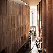 Building Name: MAC, BELFAST<br /> Building Type: CULTURE AND ENTERTAINMENT - CULTURAL CENTRE<br /> Architect: HALL MCKNIGHT<br /> Architect Website: http://www.hallmcknight.com<br /> Clients Website: http://themaclive.com<br /> Town:BELFAST<br /> Year of Completion: 2012<br /> County:ANTRIM<br /> Collection: Architecture<br /> Country: United Kingdom<br /> <br /> The building was completed by Hackett Hall McKnight in February 2012 and provides performance spaces, art galleries and supporting facilities. A new public space for the city has been provided in the foyers which recall the tight streetscape of the neighbourhood – a compressed urban environment characterised by top–light. The approach to material and construction evokes a relationship to the robust character of the preceding Victorian merchant city; large scale tough brick buildings. The construction uses the structural insitu concrete as well as the brick as an exposed finish.