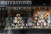 Christmas books stock in the window of a closed Chelsea branch of Waterstones on the King's Road during the second Coronavirus lockdow when most non-essential retailers and small businesses remain closed by order of the government, on 13th November 2020, in London, England.