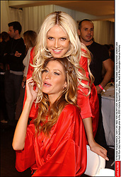 Top models Gisele Bundchen (bottom) and Heidi Klum (top) have fun backstage prior to the 2003 Victoria Secret Fashion Show, held at the Lexington Avenue Armory in New York on November 13, 2003. ( Pictured : Gisele Bundchen, Heidi Klum ) © Nicolas Khayat/ABACA  Bundchen Gisele Klum Heidi Heidi Samuel Samuel Heidi Victoria's Secret Backstage Coulisse Backstage Complicite Complicity Defile de mode Fashion Show New York City New York USA United States of America Vereinigte Staaten von Amerika Etats-Unis Etats Unis Plan americain Half length Vertical Vertical  | 52671_45