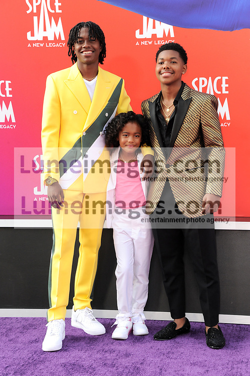 Ceyair Wright, Harper Leigh Alexander, and Cedric Joe at the Los Angeles premiere of 'Space Jam: A New Legacy' held at the Regal LA Live in Los Angeles on July 12, 2021.