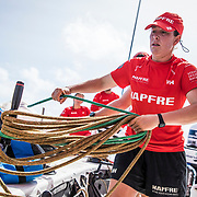 Leg 4, Melbourne to Hong Kong, day 16 on board MAPFRE, Tamara Echegoyen tiding ropes after a gybe. Photo by Ugo Fonolla/Volvo Ocean Race. 17 January, 2018.