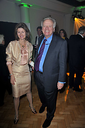 LORD GRADE and his wife FRANCESCA at the press night of the new Andrew Lloyd Webber  musical 'The Wizard of Oz' at The London Palladium, Argylle Street, London on 1st March 2011 followed by an aftershow party at One Marylebone, London NW1