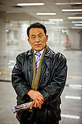 Portrait of a passerby during Christmas night at a subway station in Seoul, South Korea.