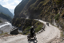 Biltwell's Patrick Lies riding his Royal Enfield Himalayan with the Biltwell crew in Motorcycle Sherpa's Ride to the Heavens motorcycle adventure in the Himalayas of Nepal. On the fifth day of riding, we went from Muktinath to Tatopani. Friday, November 8, 2019. Photography ©2019 Michael Lichter.