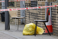 © Licensed to London News Pictures. 13/09/2021. London, UK. Two chairs and a plastic bag containing used medical equipment sit on the pavement at Ferrey Mews in Lambeth after a man was shot dead. A murder investigation is under way following a shooting in Lambeth. At 20:57hrs on Sunday, 12 September, police were alerted by the London Ambulance Service to reports of a shooting in Ferrey Mews, SW9. Officers attended with paramedics and found two people with gunshot wounds. A 27-year-old man was pronounced dead at the scene a short time later. Photo credit: Peter Macdiarmid/LNP