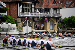 © Licensed to London News Pictures. 28/06/2017. London, UK. Spectators watch day one of the Henley Royal Regatta, set on the River Thames by the town of Henley-on-Thames in England.  Established in 1839, the five day international rowing event, raced over a course of 2,112 meters (1 mile 550 yards), is considered an important part of the English social season. Photo credit: Ben Cawthra/LNP