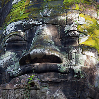 The towering face of the north gate of Angkor Thom. Angkor Thom is accessible by 5 entrance gates: the south gate, the west gate, the north gate, the victory gate, and the east gate.