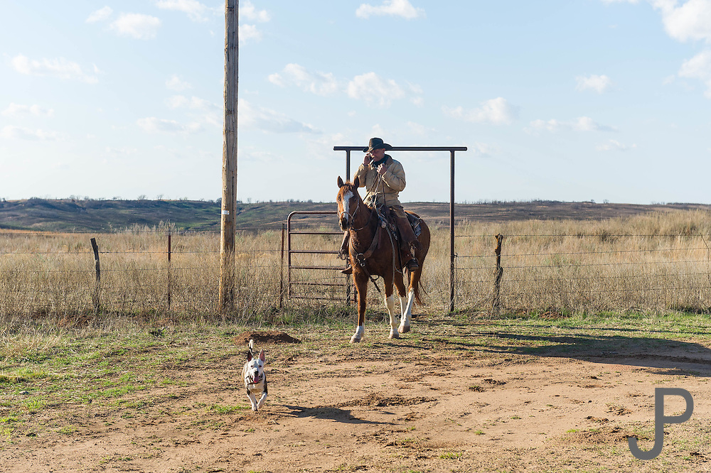 Brian Mayfield of Sayre rides his horse at the Packsaddle Wildlife Management area south of Arnett, Oklahoma.