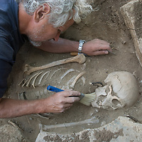 MONGOLIA. Smithsonian archaeologist & forensics specialist, Dr. Bruno Frohlich, unearths bronze-age skeleton at site above Delger River near Muren.  Skeleton may be 2700+ years old.  <br /> <br /> #MS0702_060708_0475.NEF